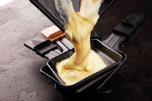 Raclette Cheese Melted Served In Individual Raclette Skillets