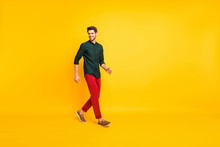 Turned Full Length Body Size Photo Of Positive Cheerful Handsome Guy Walking Towards Empty Space With Cheerful Smile Isolated Over Vibrant Color Background