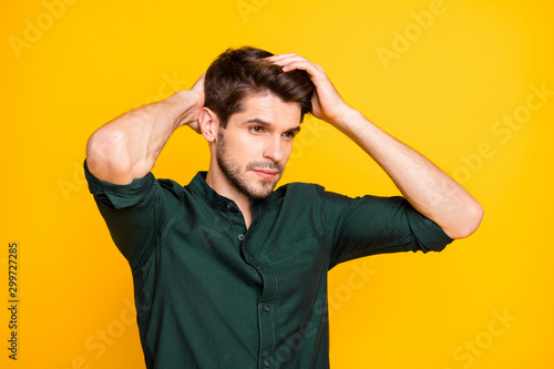 Turned photo of worried troubled man having problem of hair loss looking down di Canvas Print