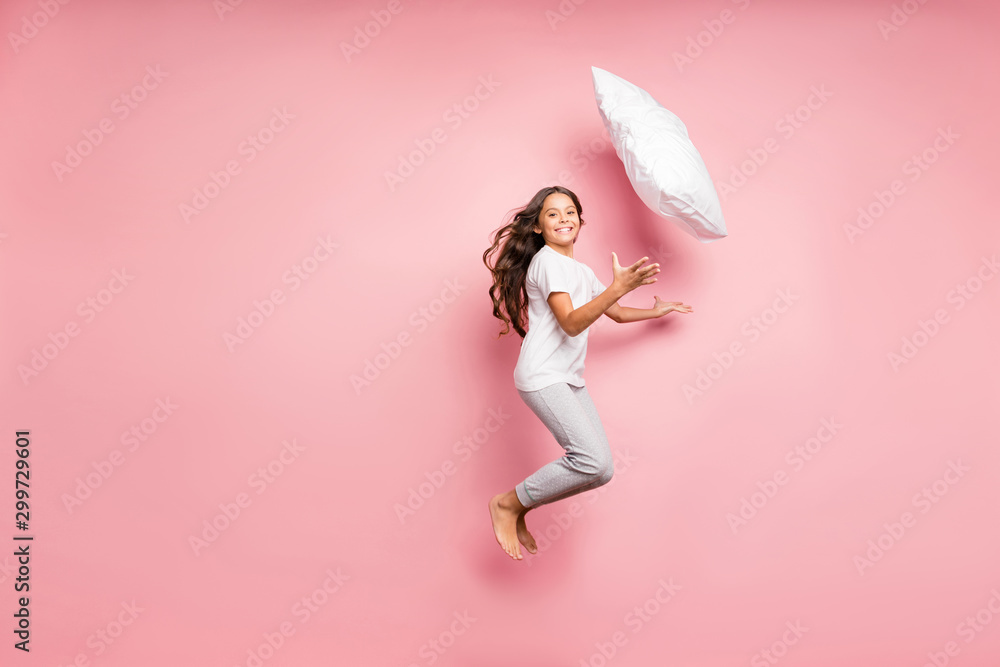 Fototapety, obrazy: Full length body size view of nice attractive lovely playful cheerful cheery wavy-haired pre-teen girl jumping throwing soft cotton pillow having fun isolated over pink pastel color background