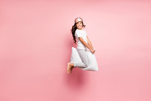 Full Length Body Size View Of Her She Nice Attractive Childish Playful Funky Cheerful Cheery Wavy-haired Pre-teen Girl Jumping Riding Pillow Party Isolated Over Pink Pastel Color Background