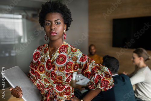 Photographie  Beautiful young confident professional black african business woman holding lapt