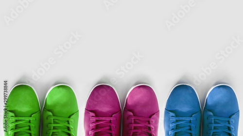 Fotografia  group of multi-colored sneakers on a white background