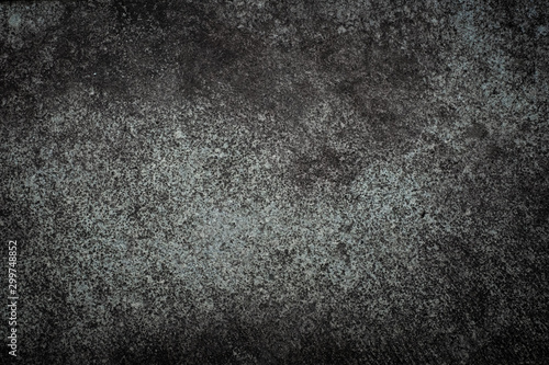 Fotobehang Stenen Dark grey stone texture with rough surface and small bubbles