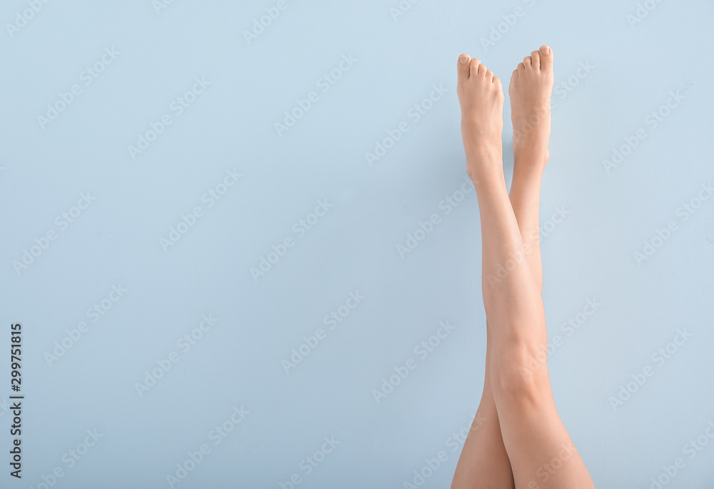 Fototapety, obrazy: Woman with beautiful legs after depilation on color background