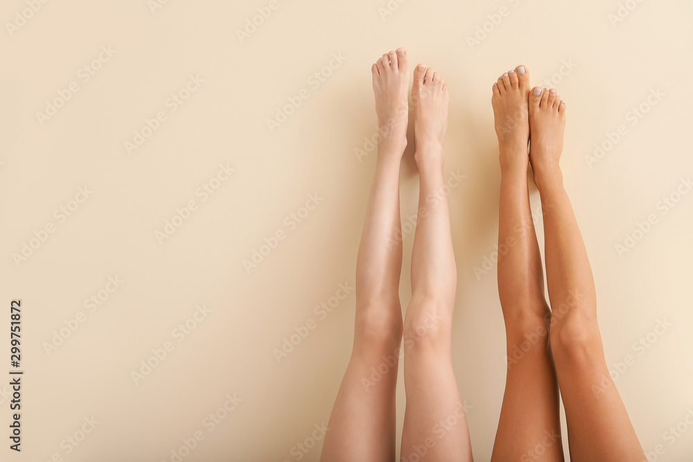 Fototapety, obrazy: Women with beautiful legs after depilation on color background