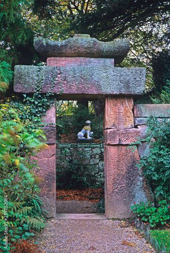 A traditional Chinese Garden with stone Gateway in a woodland setting