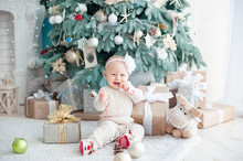 Beautiful Girl Near Decorated Christmas Tree