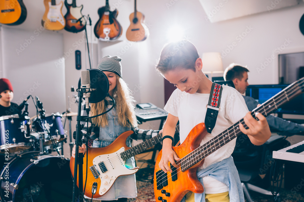 Fototapety, obrazy: Young kids rock band in music studio