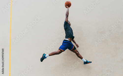 Basketball player training on a court in New york city Canvas Print