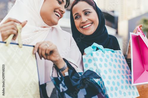 Poster Abou Dabi Two arabian girls spending time togehter outdoor making activities