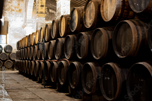 Production of fortified jerez, xeres, sherry wines in old oak barrels in sherry triangle, Jerez la Frontera, El Puerto Santa Maria and Sanlucar Barrameda Andalusia, Spain