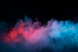 canvas print picture - Abstract texture of backlit smoke in red blue on a black background.