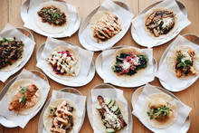 Variety Of Tacos Served On Plates