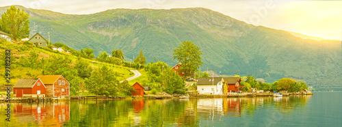 Fotobehang Noord Europa Village houses sea view, Norway. Norwegian fjords green landscape, Rosendal rural town.