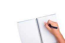 Top View Of The Human Hand Is Holding A Pen And Writing In A Notebook With Lined Lines On Isolated White Background With Clipping Path.