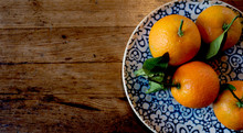 Orange Fruits With Leaves In A...