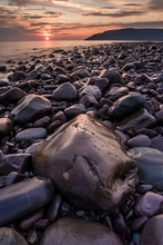 Rocky Seashore At Sunrise