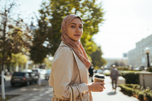 Muslim Woman In The City With A Cup Of Coffee