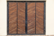 Massive Wooden Gates With Knoc...