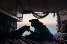 Woman With Dog In A Camper Van