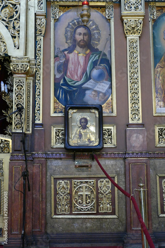 Photo Icons on the Iconostasis that separates nave from apse