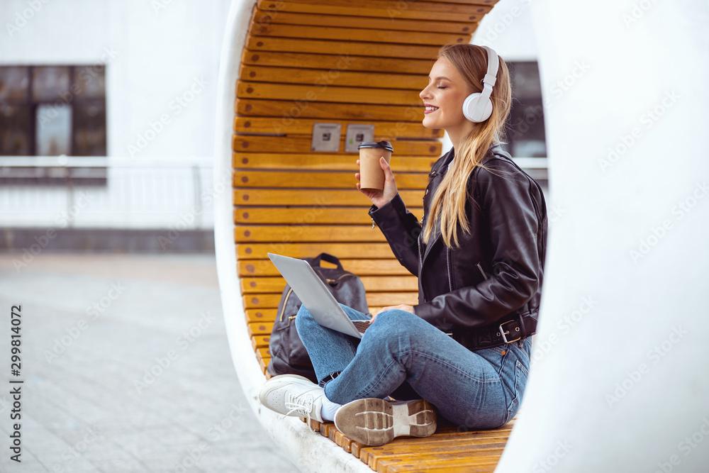 Fototapeta Pleased student girl taking a rest outside