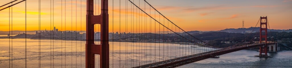 Panoramic of San Francisco California through Golden Gate Bridge at Sunrise