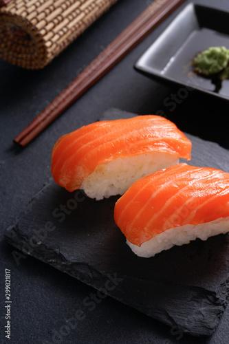 Printed kitchen splashbacks Sushi bar Salmon Nigiri Sushi on black slate stone with soy sauce and wasabi