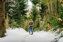 Couple Loving In Conifer Fores...