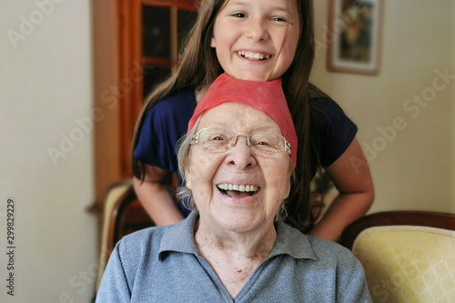 Photo Crazy Senior Lady with Granddaughter