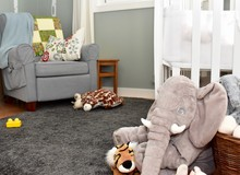 Beautiful Child's Bedroom With Chair And Plush Toys