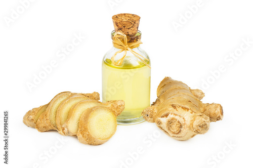 Leinwand Poster Glass bottle of essential ginger oil, ginger root and powder isolated on white background