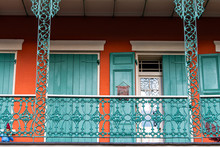 New Orleans Old Town Street In Louisiana Famous City With Cast Iron Balconies And Colorful Door