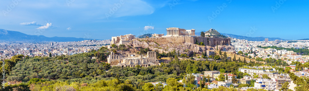Fototapeta Panorama of Athens with Acropolis hill, Greece. Famous old Acropolis is a top landmark of Athens. Landscape of the Athens city with classical Greek ruins. Scenic view of remains of ancient Athens.