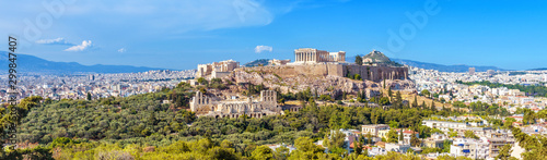 Panorama of Athens with Acropolis hill, Greece. Famous old Acropolis is a top landmark of Athens. Landscape of the Athens city with classical Greek ruins. Scenic view of remains of ancient Athens.