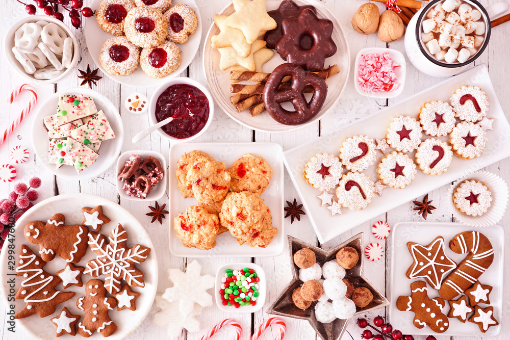 Fototapety, obrazy: Christmas sweets and cookies. Top view table scene over a white wood background. Holiday baking concept.
