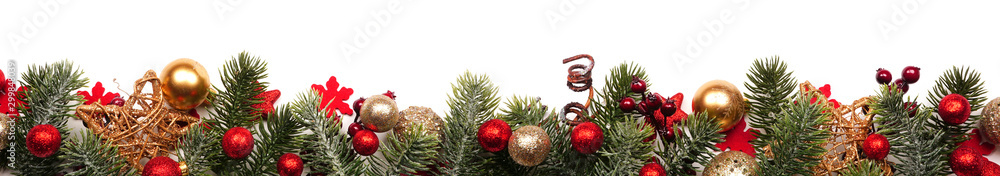 Fototapeta Long Christmas border banner of red and gold ornaments and branches isolated on a white background
