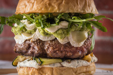 Burger, Sandwich, Meat, Filler, Rucola, Sauce, Bread With A Cutlet, American Cuisine. Traditional Beautiful Burger, Ingredients And Burger Details. Food Photo