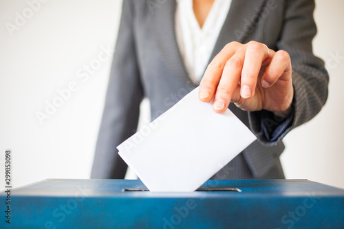 elections - The hand of woman putting her vote in the ballot box