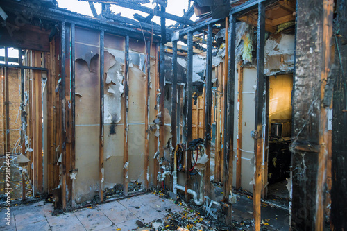 Burnt wooden walls house with charred roof burnt Wallpaper Mural