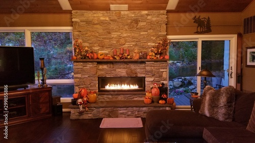 Photo Cozy Home with Beautiful, Large Stone Masonry Fireplace in Subtle Earth Tones, L