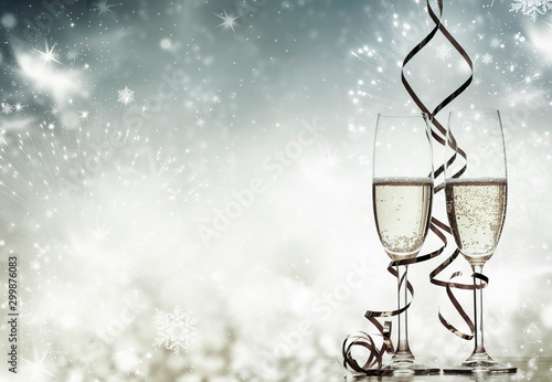 two champagne glasses with ribbons against holiday lights and fireworks - New Ye Tapéta, Fotótapéta