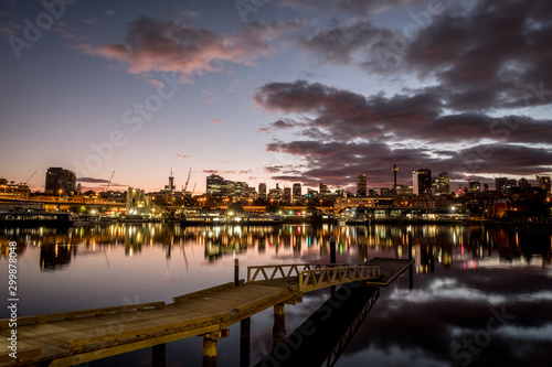 roxers pier and city skyline at sunrise Wallpaper Mural