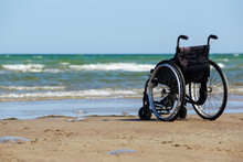Wheelchair Stands On The Seash...