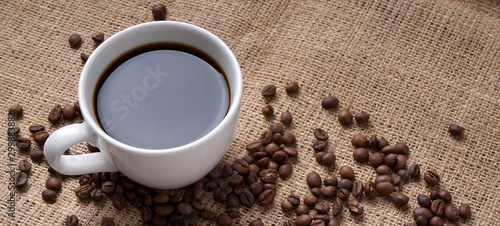 Wall Murals Cafe cup of coffee and coffee beans on jute