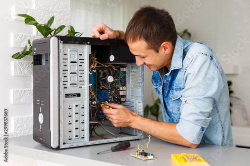 Fotomural  Computer engineer working on broken console in his office
