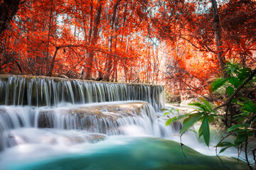 Fototapeta Do biura Amazing in nature, beautiful waterfall at colorful autumn forest in fall season