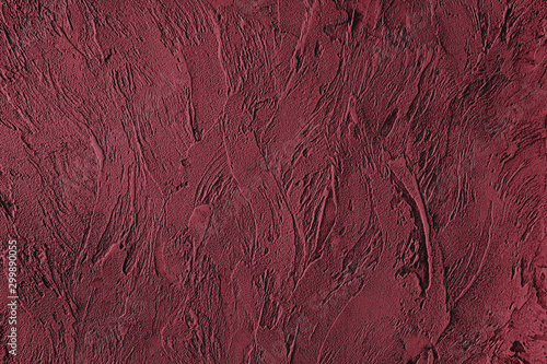 Photo Dark red colored low contrast Concrete textured background with roughness and irregularities to your design or product