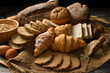 Variety of bread on old wooden background